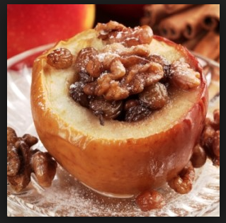 An image of a backed apple with walnuts